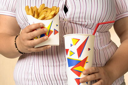 Overweight teenager with fries   Original Filename: overweight.jpg