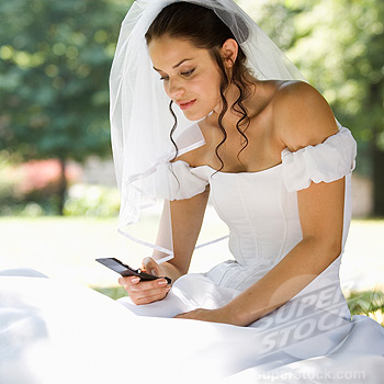 A bride using a mobile phone